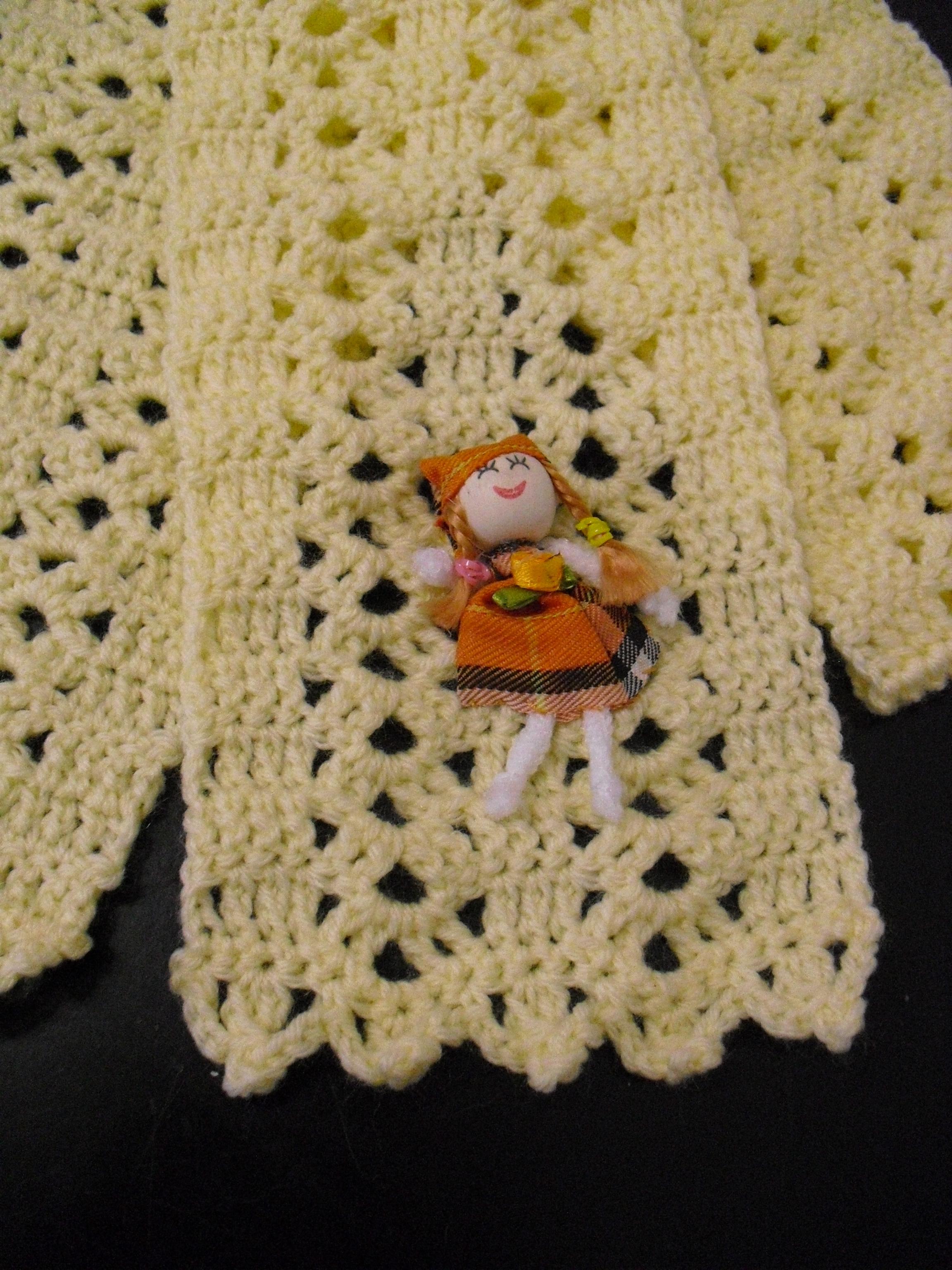 Pormenor do ponto de crochet e da boneca