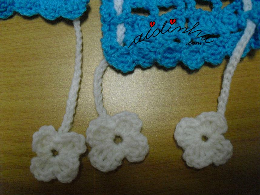 Pormenor das florinhas do cordão do cachecol