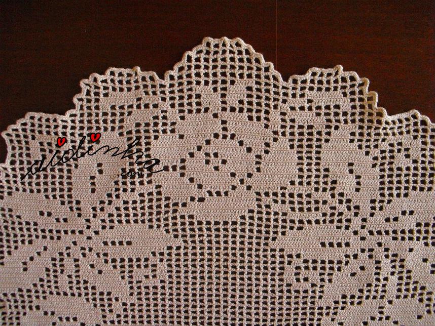 Pormenor do caseado do naperon de crochet, creme
