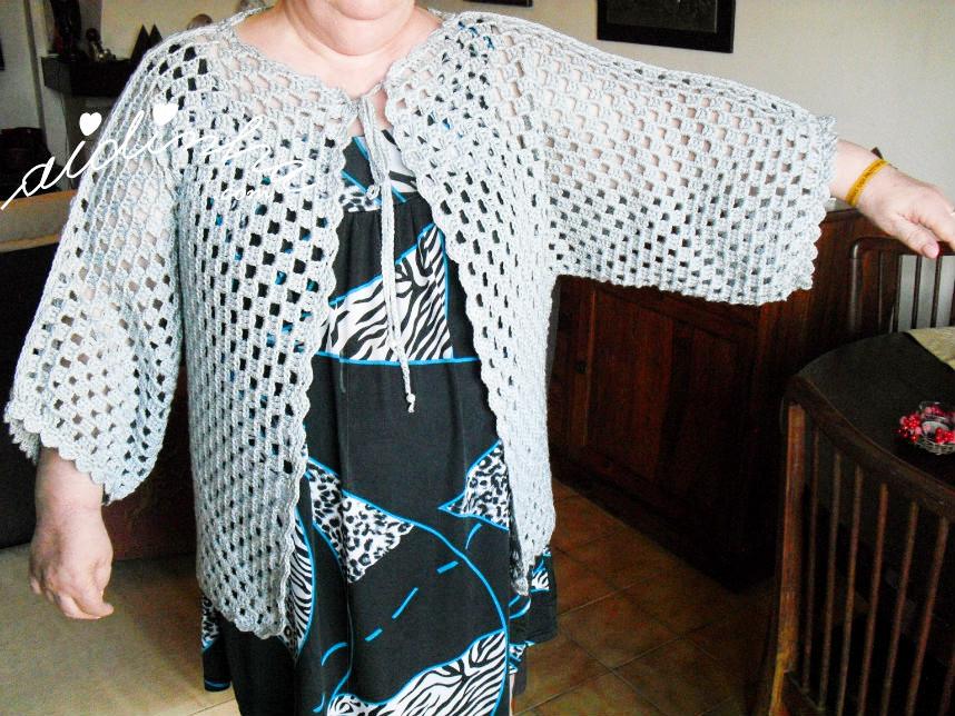 Manga do casaco de crochet, vista de frente