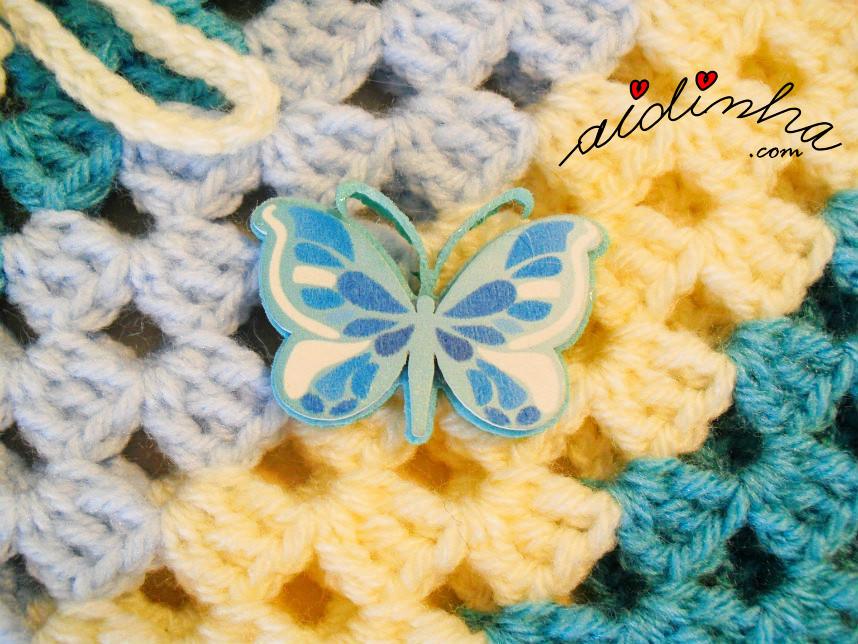 Imagem da borboleta que enfeita o poncho infantil