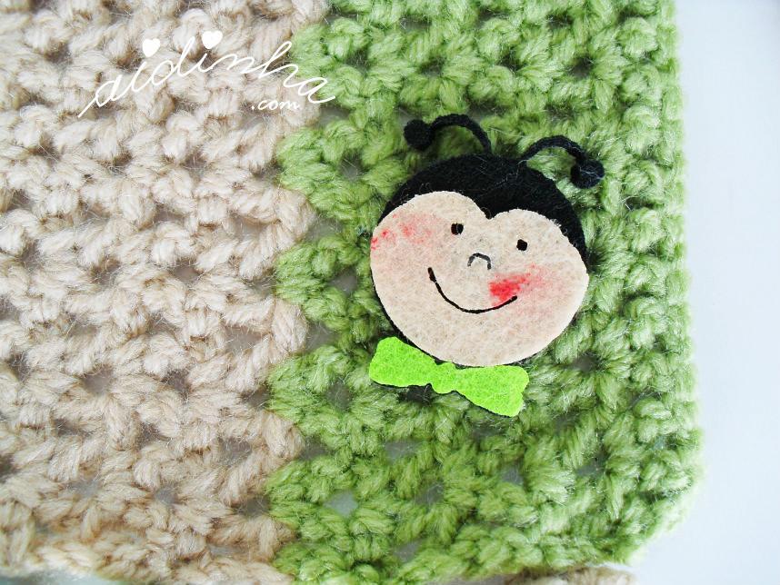 Imagem da joaninha do cachecol de crochet infantil