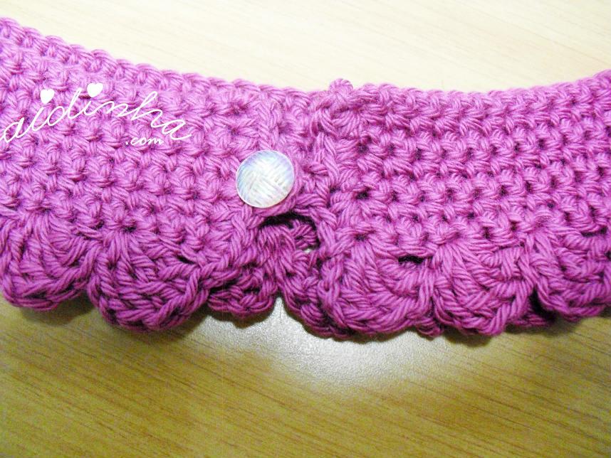 Foto do botão que fecha a golinha infantil, de crochet