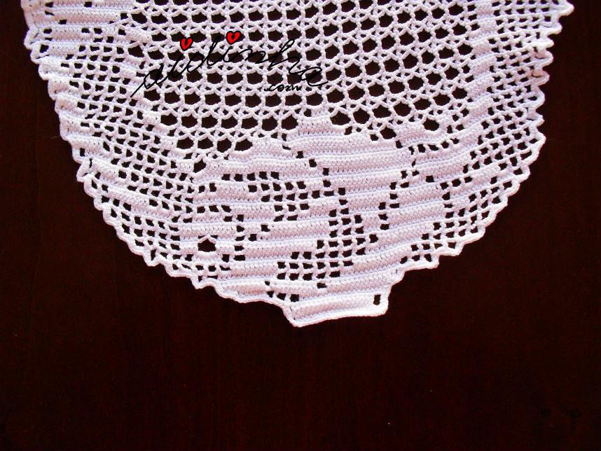 Foto da rosa dos topos do naperon de crochet
