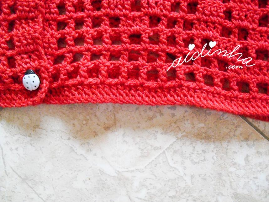 Foto da parte de baixo do casaco vermelho