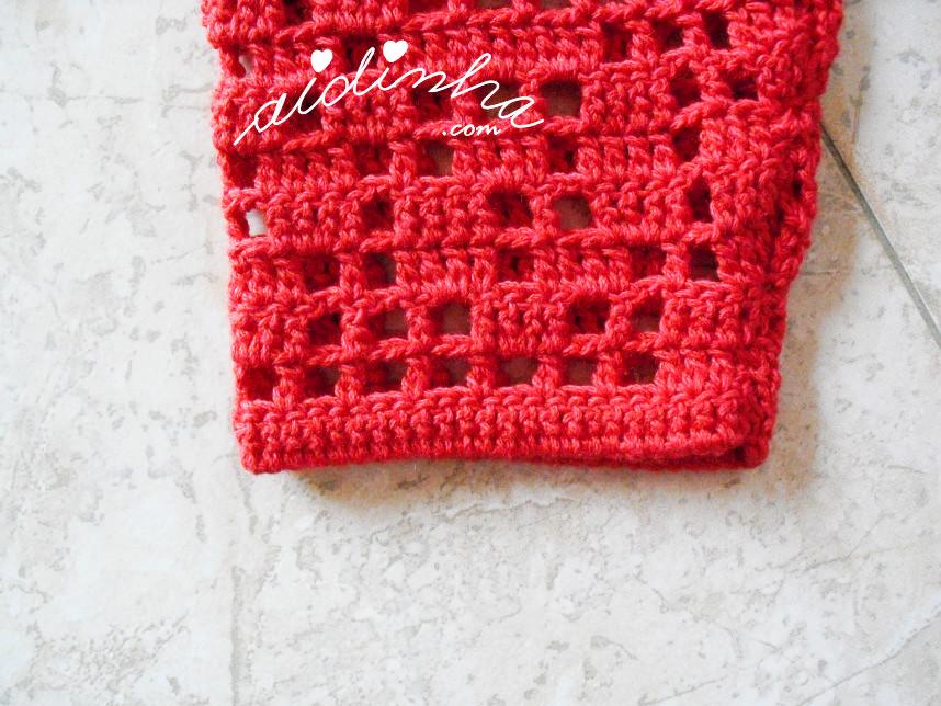 Foto do punho do casaco vermelho