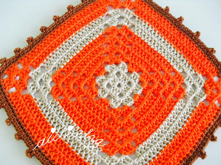 Pega ou agarrador de crochet, laranja, vista de perto