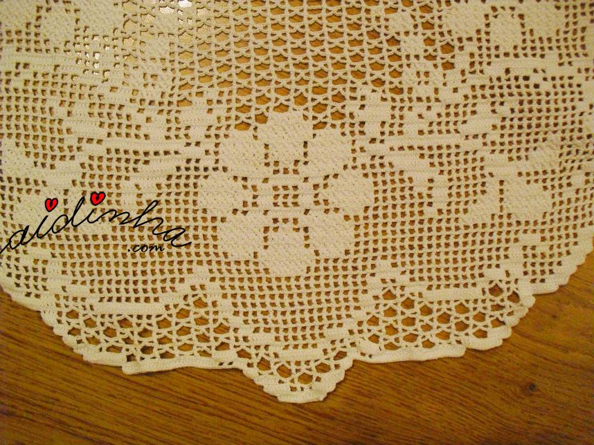 Foto das flores da toalha redonda de crochet