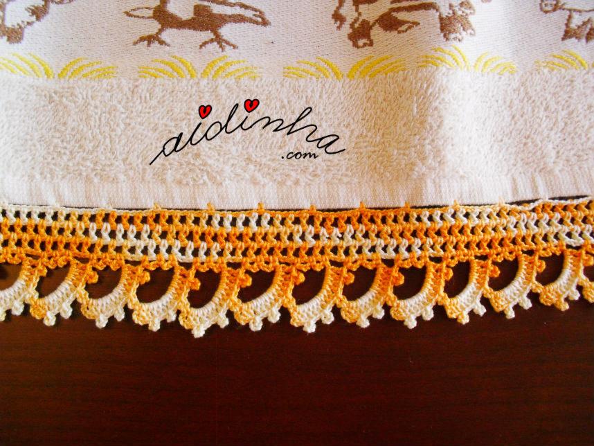 Imagem do crochet do pano de cozinha amarelo e creme