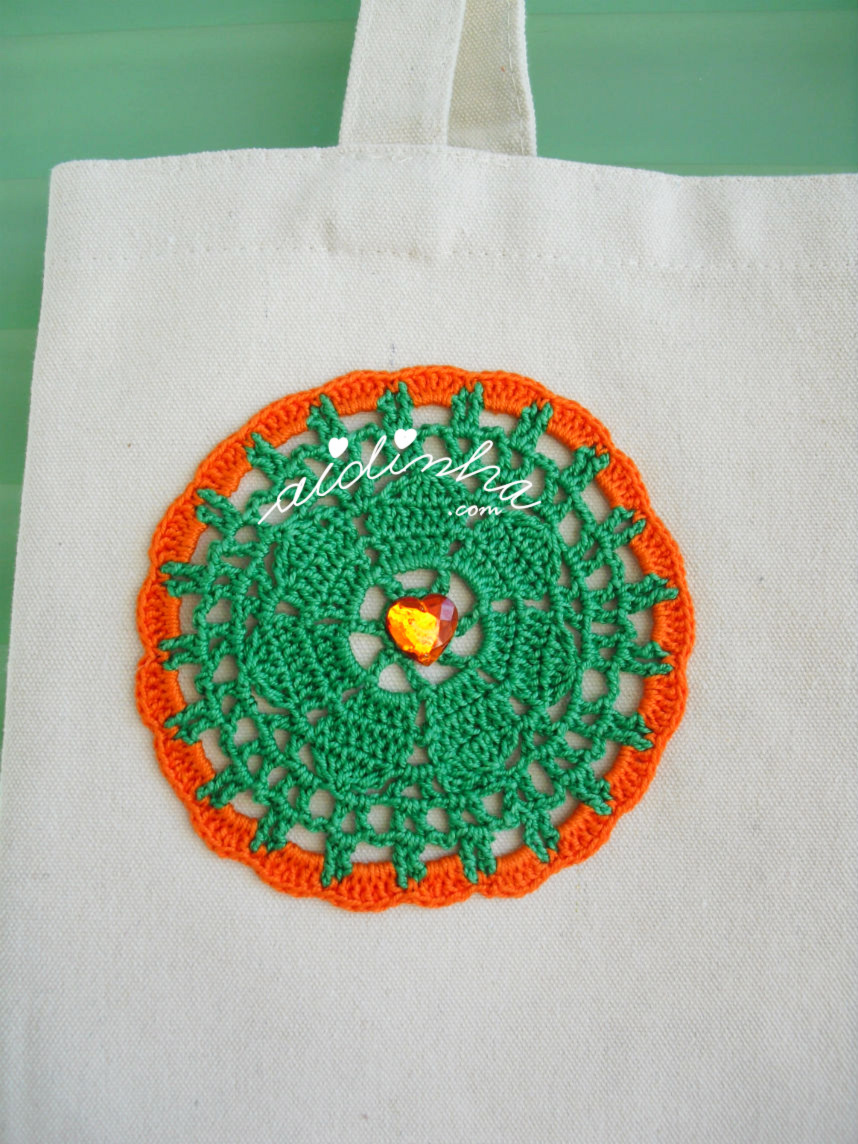 Roseta de crochet laranja e verde