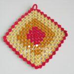 Conjunto de toalhinha e pega em crochet
