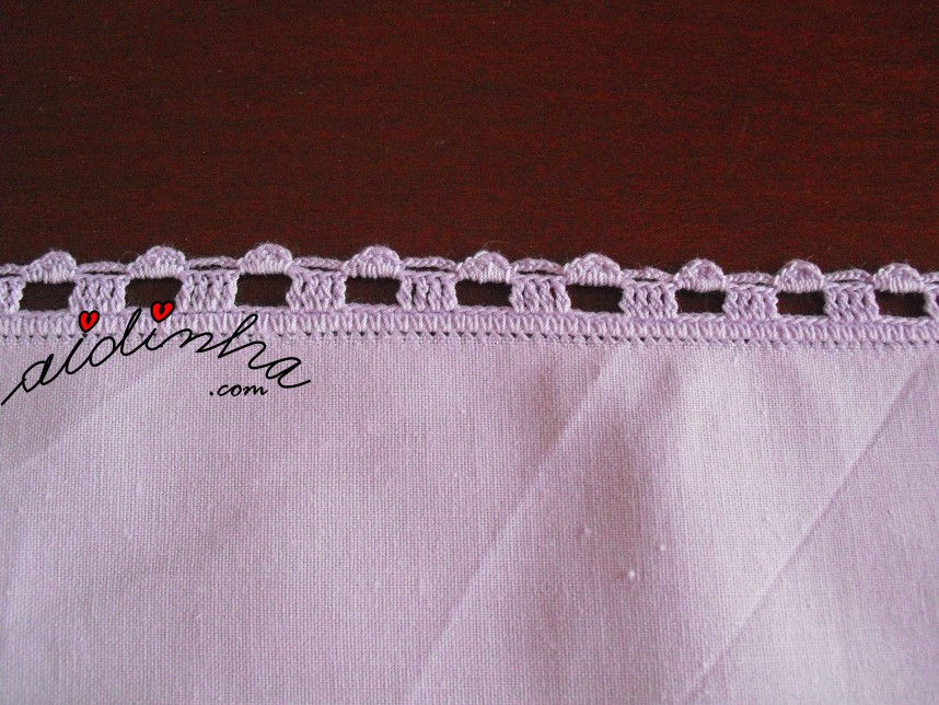 pormenor do crochet do individual lilás